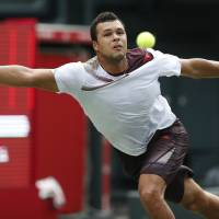 That's a stretch: Jo-Wilfried Tsonga reaches for a ball during his first-round match against fellow Frenchman Gael Monfils at the Japan Open on Monday. Tsonga won 6-3, 7-6 (10-8). | AP