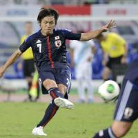 Strike while the iron's hot: Japan's Yasuhito Endo scores a 76th-minute goal against Guatemala on Friday in Osaka. Japan defeated Guatemala 3-0 in the international friendly. | KYODO