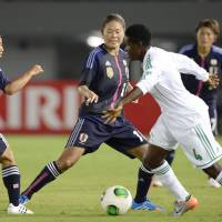 Hold steady: Japan's Yoko Tanaka (left) and Homare Sawa (center) defend during Sunday night's 2-0 friendly win over Nigeria. | KYODO