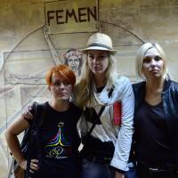 Running scared: Femen founders Anna Hutsol (left), Oleksandra Shevchenko (center) and Yana Zhdanova pose in Kiev after police searched the organization's office on Tuesday and claimed to have found weapons. | AFP-JIJI