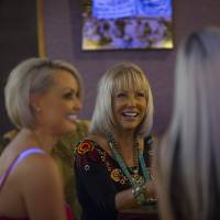 Ladies of the night: Susan Austin (center), the madam for the Mustang Ranch, talks with sex workers Jaylynn Jones (left) and Amaris inside the brothel in Sparks, Nevada, last month. | BLOOMBERG