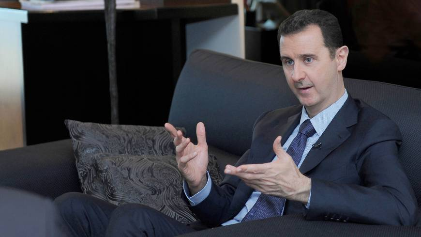 Regime commander: Syrian President Bashar Assad speaks during a recent interview with a Russian newspaper in Damascus. | AP