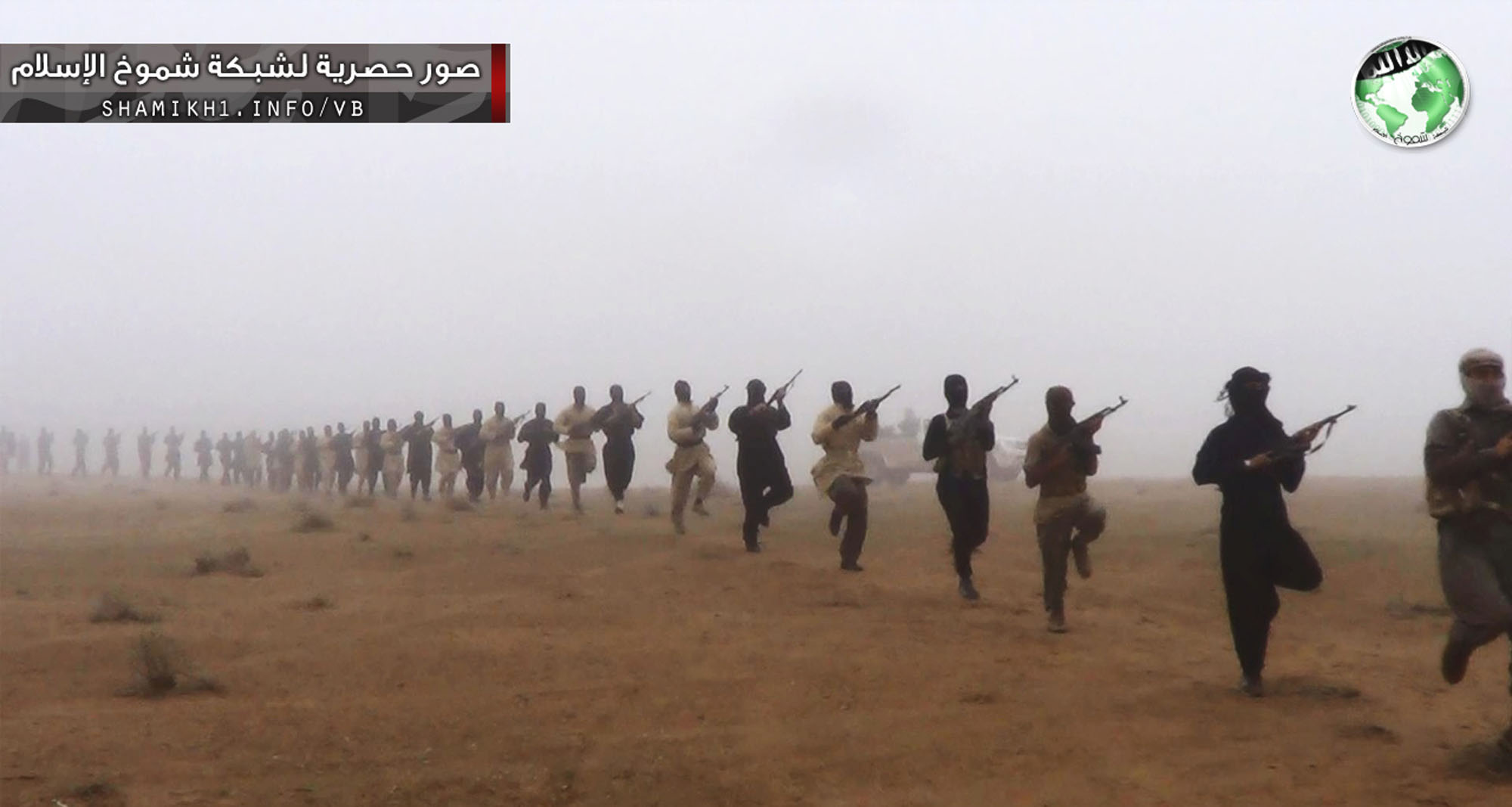 Training day: Suspected militants train in Iraq near the Syrian border. Islamists from extremist groups such as Jabhat al-Nusra and the Islamic State of Iraq and the Levant have been abandoning local headquarters in Syria and moving military equipment ahead of possible U.S. strikes on the regime. | AP