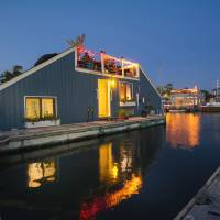 Floating world: Karen Anderson's houseboat, Serendipity 2, at Gangplank Marina in Washington, is a barge that looks like a house with the top cut off. | THE WASHINGTON POST
