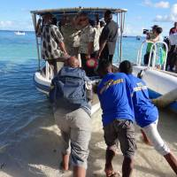 Trouble in paradise: Pacific Island Forum leaders leave Eneko Island en route to the Marshall Island's capital of Majuro on Sept. 5. That day, the Pacific island nations adopted the 'Majuro declaration,' which sets out ambitious climate targets. | AFP-JIJI