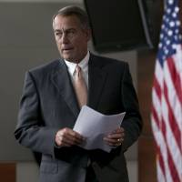 House divided: Speaker John Boehner arrives for a news conference in Washington on Thursday. | BLOOMBERG