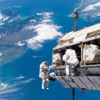 Spaced out: Astronauts Robert Curbeam of the United States and Christer Fuglesang  of Sweden work to attach a new truss segment to the International Space Station and begin an upgrade to the power grid in December 2006. | ASTRONAUTS TAPPED FOR SERVICE ON THE ISS TRAIN UNDER WATER THE WASHINGTON POST