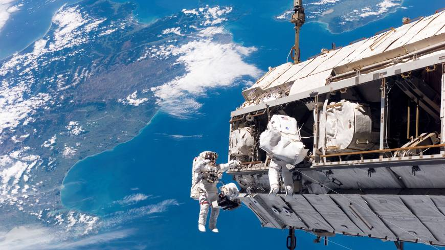Spaced out: Astronauts Robert Curbeam of the United States and Christer Fuglesang  of Sweden work to attach a new truss segment to the International Space Station and begin an upgrade to the power grid in December 2006.