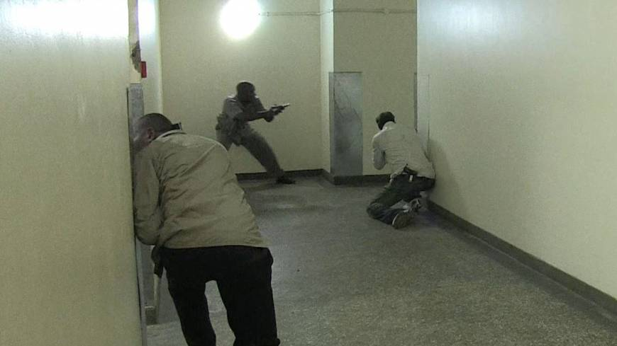 Kenyan security forces search inside the mall for remaining gunmen on Saturday.