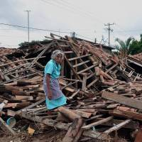 Mexico turns to rebuilding after deadly storms