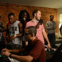 Making music: Producer and manager Miguel Pena (foreground) takes care of the sound mixing for rappers Pacman (third from left) and Peso (left) during a Sept. 12 rehearsal and recording session at the Washington home of Ramsey Aburdene (third from right). Also shown are Josh Wiley (second from right), Michael Bassett (right) and Domo Bang (second from left). Pacman and Peso plan to travel to North Korea to make a rap video. | THE WASHINGTON POST