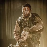 Leaving a lot on stage: James McAvoy, as Macbeth, holds an ax to Kevin Guthrie, as Lennox, in a production of 'Macbeth' in London on Feb. 8, 2013. | BLOOMBERG