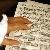 Complex: A wax figure of Johann Sebastian Bach rests its hand on sheet music for a violin sonata at Madame Tussauds in Berlin in July 2008. | BLOOMBERG