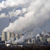 Aiding climate change: Steam and smoke rise from a coal-burning power station in Gelsenkirchen, Germany, in December 2009. | AP
