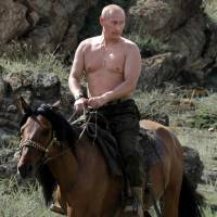 Siberian summer: Current Russian President Vladimir Putin rides a horse during a vacation outside the southern Siberian town of Kyzyl in August 2009, when he was prime minister. | AFP-JIJI