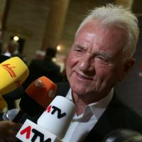 Money talks: Austro-Canadian billionaire Frank Stronach, of his Team Stronach party, talks to media on arriving at parliament for a TV discussion in Vienna on Sunday. | AP