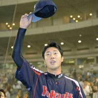 First timer: Swallows pitcher Kenichi Matsuoka waves to the crowd after throwing a shutout against the Giants on Wednesday.  | KYODO