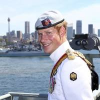 Britain's Prince Harry reviews global armada in Sydney