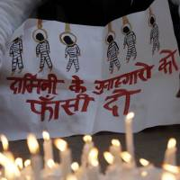Sending a message: A protester holds a banner during a rally held in New Delhi last Dec. 30 following the cremation of a young woman who was viciously raped by a gang of men in a bus in the Indian capital a short while before. | AFP-JIJI
