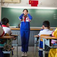 Eye on the prize: Students do eye exercises to help relax at Beijing's Jingshan School, one of China's most elite. Despite the nation's campaign against corruption, many parents continue to pay bribes to get their children into top schools.   THE WASHINGTON POST