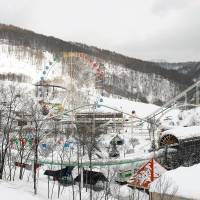 Bust: A shuttered amusement park lies empty in Yubari, the Hokkaido city whose name has become synonymous with bankruptcy. In the latest edition of Sapio magazine, pundits duel over the notion that Japanese should learn to live happily with less. Management consultant Kenichi Ohmae fears that such thinking could lead to Japan's 'Yubari-ization.' | BLOOMBERG