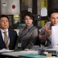 Work rules: Yuko Takeuchi (center) plays the title role in NTV's new comedy drama 'Dandarin.' She is flanked by Kenji Mizuhashi (left) and Koji Okura. | NTV