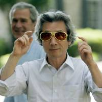 Bright future: Then-Prime Minister Junichiro Koizumi puts on Elvis-style shades after being taken on a tour of Graceland, the Memphis, Tennessee, home of Elvis Presley, by U.S. President George W. Bush in 2006.   AP
