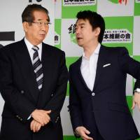 Strange bedfellows: Osaka Mayor  Toru Hashimoto (right) chats to fellow co-leader of the Japan Restoration Party Shintaro Ishihara in  Tokyo in June. Hashimoto announced last month that Osaka Prefecture and city will jointly submit a proposal to the Cabinet Office to set up a Special Challenge Zone where some labor protections would be relaxed or waived. | AFP-JIJI