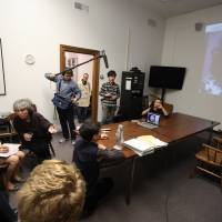 Hibakusha: Students in Field's class on nuclear energy and weapons videoconference with atom bomb survivor Akiko Matsumoto while award-winning Japanese-language poet Arthur Binard translates and a crew from NHK films for a television special. | DREUX RICHARD