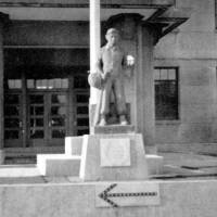 Go figure: Photo from 1948 shows a statue of Sgt. Frederick A. Burness Jr. in front of the entrance to the 720th Military Police Battalion's base in the former Imperial Japanese Naval Academy's School of Accounting in Tsukiji,  Tokyo. | COURTESY OF JACK MARQUARDT