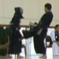 Too much: Cell phone pictures appear to catch a kendo coach kicking a student at a junior high school in Oita City in September 2011. | KYODO