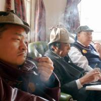 Not the Japan  Writers Conference: Men puff on pipes as they imitate Sherlock Holmes at the English House in Kobe's historic Kitano Ijinkai district of former foreign residences in 2010. One Japan-based author advises new writers to heed the words of Arthur Conan Doyle's detective if they want to succeed in the world of publishing. | KYODO