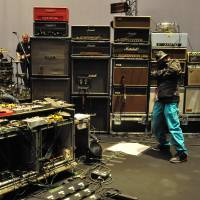 All systems go: Dommune founder Naohiro Ukawa stands with My Bloody Valentine's equipment prior to the band's performance at the Tokyo International Forum on Sept. 30. Ukawa promised a sound spectacular — and he delivered.
