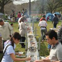 Harvest feed: Visitors to Narita Yume Bokujo choose meats from the harvest festival's long grill.