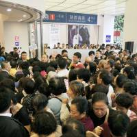 Bragging rights: Customers pour in to the new Uniqlo store in Shanghai on Monday. Fast Retailing says it is the largest Uniqlo outlet in the world. | KYODO