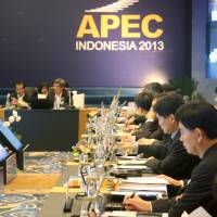 Nitty-gritty: APEC member state delegates hold discussions Tuesday during their three-day high-level working group session in Nusa Dua, Indonesia. | KYODO