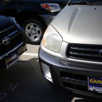 Kicks the tires: Toyota models are for sale at a CarMax used-car dealer in Lexington, Kentucky, on Sept. 23. | BLOOMBERG