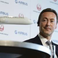 Done deal: Fabrice Bregier, chief executive officer of Airbus SAS, speaks during a joint news conference with Japan Airlines Co. President Yoshiharu Ueki in Tokyo on Monday. | BLOOMBERG
