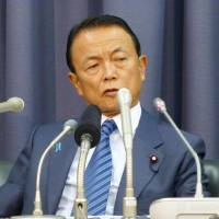 Tax advocate: Finance Minister Taro Aso speaks to reporters at the ministry on Tuesday. | KYODO