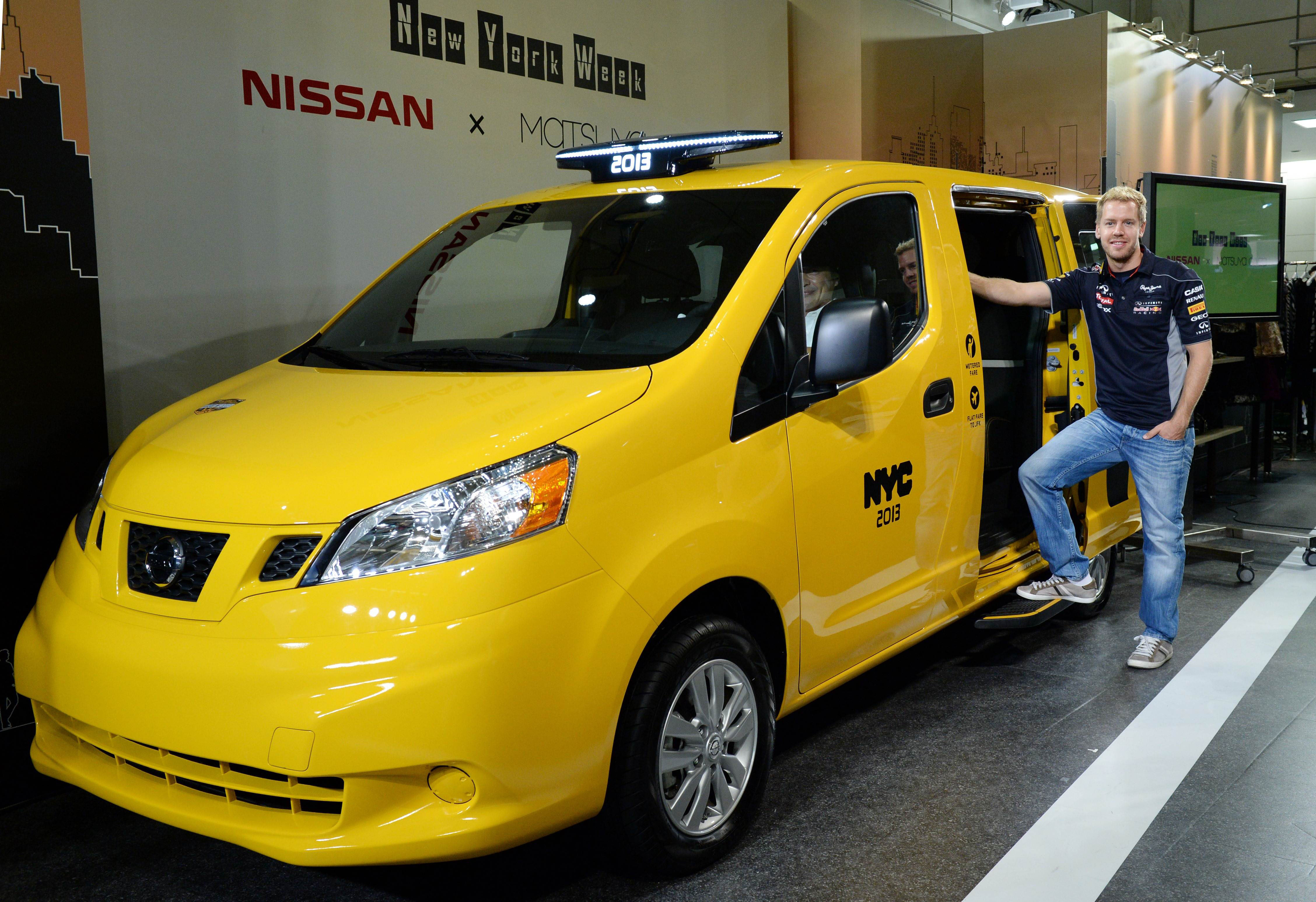 One color fits all: German three-time Formula One champion Sebastian Vettel poses besides Nissan Motor Co.'s NV200 'New York Taxi of Tomorrow' during its press preview Wednesday in Tokyo's Matsuya Ginza department store during the store's weeklong New York Week fair. | AFP-JIJI