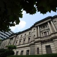 Staying tuned: A Bank of Japan policymaker stressed the importance of adjusting monetary policy without hesitation if the economy deteriorates, according to the minutes of last month's meeting. | BLOOMBERG