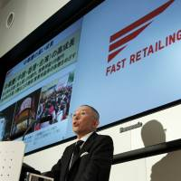 On the up and up: Fast Retailing Co. chief Tadashi Yanai annouces the firm, which operates the Uniqlo casual clothing chain, posted record net sales of ¥1.143 trillion in the last business year on rapid growth in Asia, at a Thursday news conference in Tokyo. | BLOOMBERG