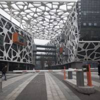 Journey of 1,000 miles: Workers enter Alibaba.com Ltd.'s headquarters in Hangzhou, China. | BLOOMBERG