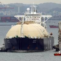 Core of inflation: The Liberian LNG tanker Umm Al Ashtan arrives at Yokohama on Monday. Japan's trade deficit ballooned to a fresh record for September as the cost of importing energy and other goods  outstripped growth in exports. | AP