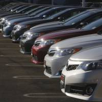 Turnkey: New Camry and Avalon models sit in the DCH Auto Group Toyota Dealership lot in Torrance, California, in July. | BLOOMBERG