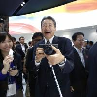 Sony's Hirai mixes camera, phone geeks to catch Apple