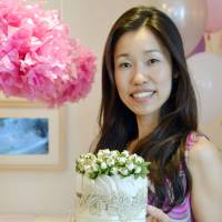 Icing on the cake: Midori Tomida, head of Babyshower Japan, shows a diaper cake, a popular gift for baby showers. | KYODO