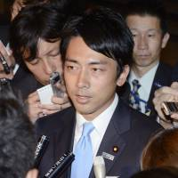 Prime time: Shinjiro Koizumi responds to reporters' questions at the prime minister's office in Tokyo on Monday. | KYODO