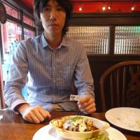 Payment in kind: Koichiro Tawa, co-founder of IT startup Timers, has lunch at a pub in Roppongi, Tokyo, using one of the coupons his company received in exchange for creating the establishment's website. | TOMOKO OTAKE