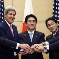 Unified security: Prime Minister Shinzo Abe (center) poses with U.S. Defense Secretary Chuck Hagel (left), U.S. Secretary of State John Kerry (second from left), Foreign Minister Fumio Kishida (second from right) and Defense Minister Itsunori Onodera during a meeting at the Prime Minister's official residence in Tokyo on Thursday. | POOL